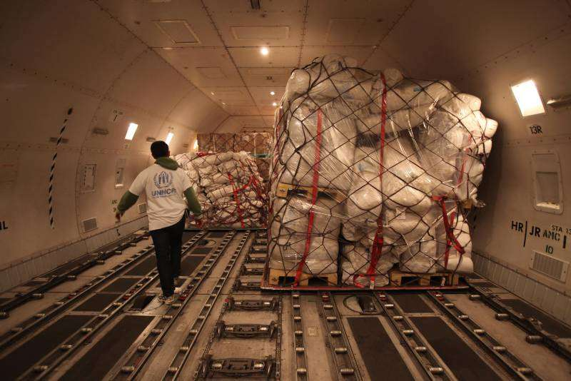 Among the UNHCR aid items airlifted to Tunisia were tents, sleeping mats, blankets and jerry cans.