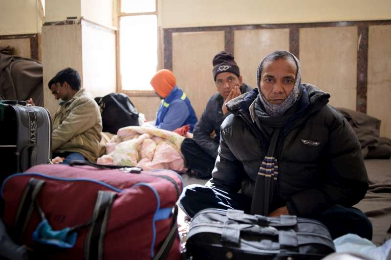 A Bangladeshi man sits in a waiting room at the Egyptian-Libyan border in Sallum, Egypt. He and his compatriots had been stuck there for five days and were short of food, water and money.