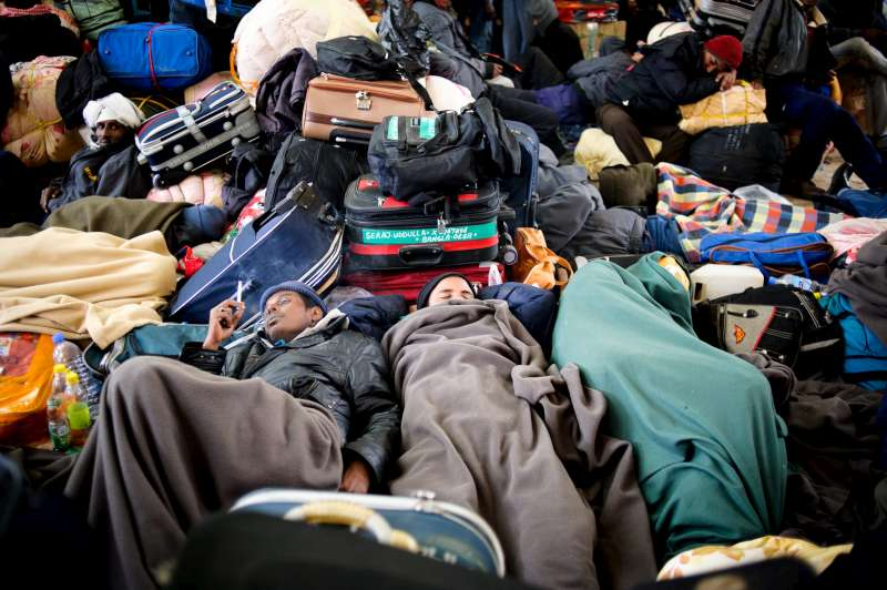 People sleeping on the floor in Sallum, Egypt, after arriving from Libya.