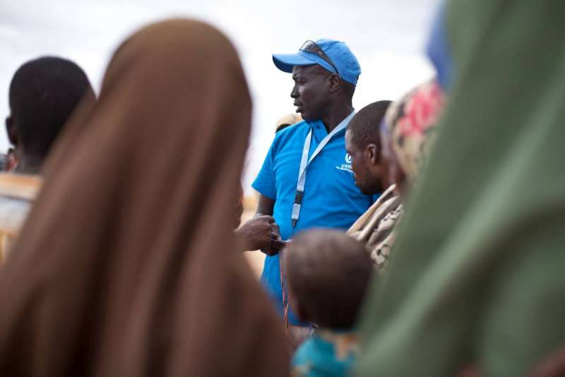 UNHCR's emergency response coordinator, Henok Ochalla, processes refugees for relocation to Ifo Extension.
