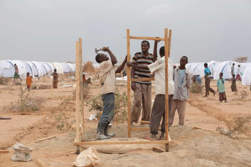 Men working to build latrines for refugees recently relocated to Ifo Extension.