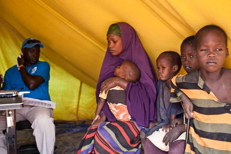 A Somali refugee family is registered to receive a tent at the Ifo Extension site.