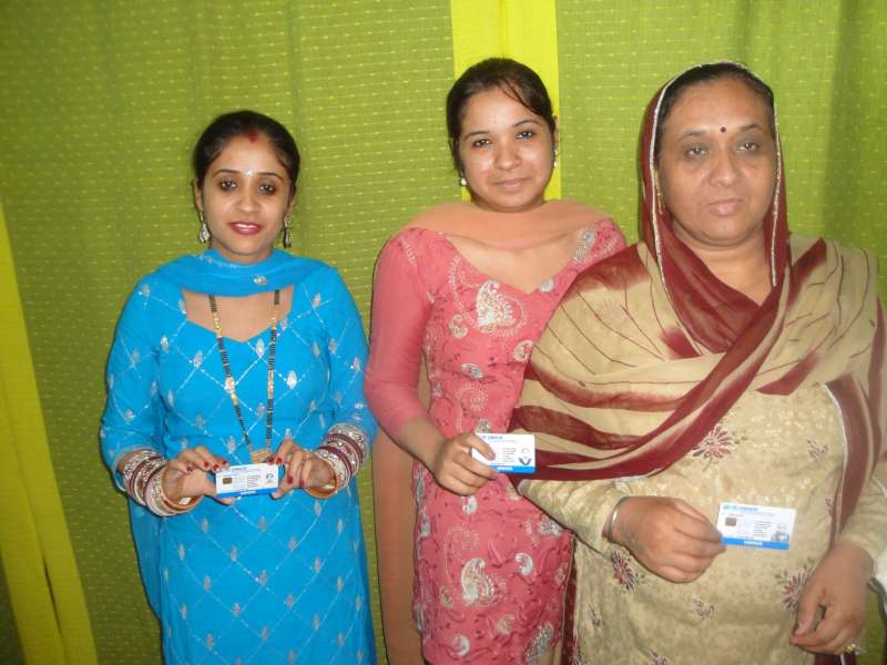 unhcr unhcr distributes pioneering smart id cards to refugees in india