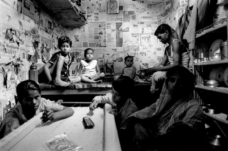 Overcrowding plagues many Bihari settlements in Bangladesh. Living conditions are cramped and pose safety and health problems. Families of as many as 15 members live in rooms of less than 10 square metres. This family of seven work in their newspaper-covered room in Kurmi Tola Camp in the capital, Dhaka.