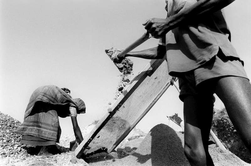 Dalits who are not hired to farm the land often end up as labourers earning the equivalent of less than US$1 a day. In this image, two of them shovel gravel and rocks from the dried bed of the Khuti River.