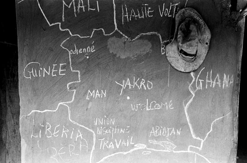 "A map of West Africa is drawn in chalk on the wall of a home in a village in south-western Côte d'Ivoire. Millions of people from surrounding countries like Burkina Faso, Mali and Ghana were welcomed into Côte d'Ivoire in the 1960s and 70s to build the country's economy. As a result, a third of Côte d'Ivoire's population is now considered to be of non-Ivorian descent. In the 1990s, politicians and intellectuals created the xenophobic concept of ""Ivoirité"" and have since exploited this divide to manipulate issues of nationality, documentation, voting rights and land ownership."
