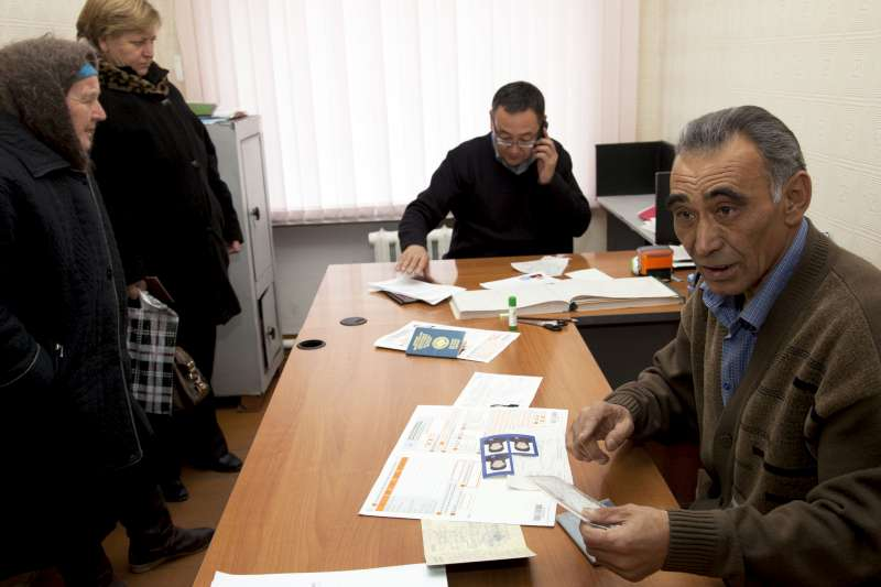 A consultant from a local NGO works along side a Kyrgyz state official who handles applications for passports, naturalization, registration and documentation. This partnership is part of a UNHCR-supported initiative to identify stateless people and provide them with free legal counselling and with help in gathering the documentation needed to apply for citizenship.
