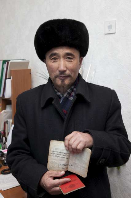 This man, like thousands of other stateless people in the country, has only an expired Soviet passport as identity. He was photographed in the rural office of a local NGO, whose advice he sought on how to get Kyrgyz citizenship and a passport.