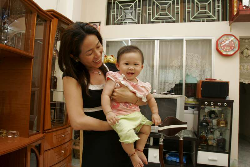 Vietnamese Nguyen Thi Diem Chi, 33 and her daughter Nguyen Lam Gia Lac at their house in Ho Chi Minh City, Viet Nam. Chi married a Taiwanese man, but later divorced. When the photo was taken in 2007, she had neither Vietnamese nor Taiwanese citizenship. Since then she received Vietnamese citizenship.