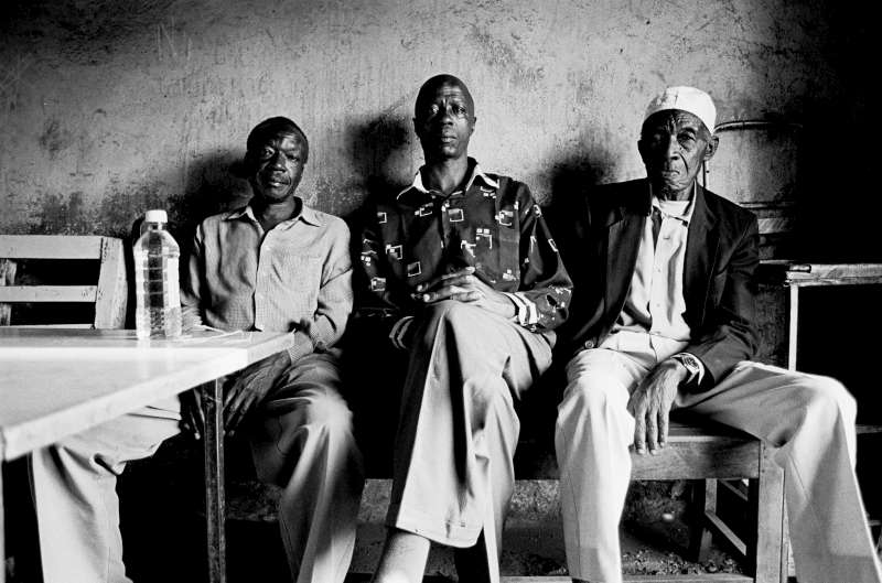 Having lived in Kenya for over 100 years, the Nubian community in Kenya has historically been denied recognition. Up until the most recent census conducted in mid-2009, the Nubian community was considered as 'Other Kenyans' or simply 'Others'. Three men from the Nubian community sit in a small shop in the Kibera slum.