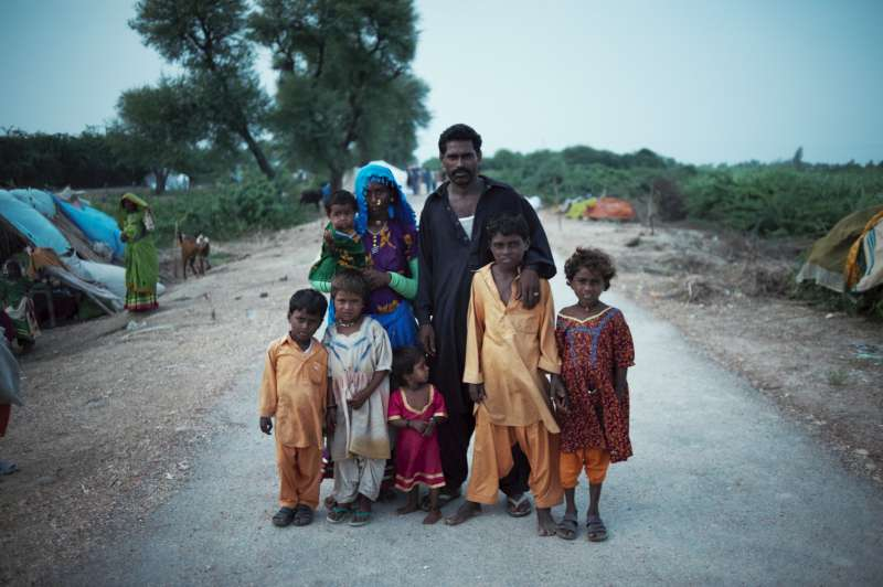 A family of eight prepares to settle at a spontaneous site in Badin district.