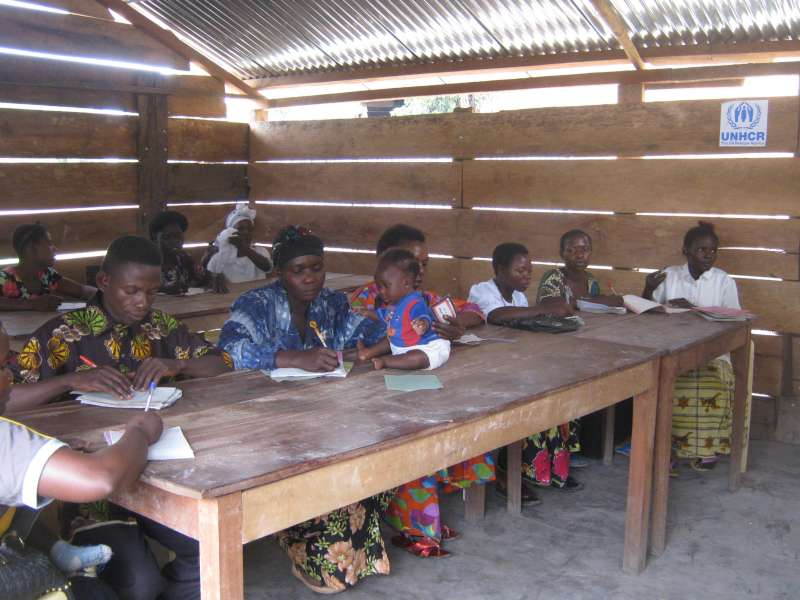 Adult literacy classes like this one in Dungu help traumatized women work ...