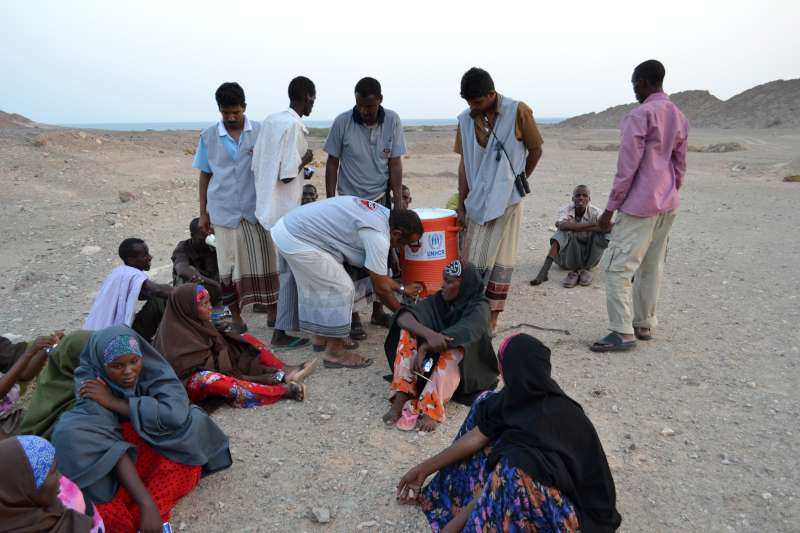 SHS provides water to a group of women recovering on the beach after the difficult journey from the Horn of Africa.