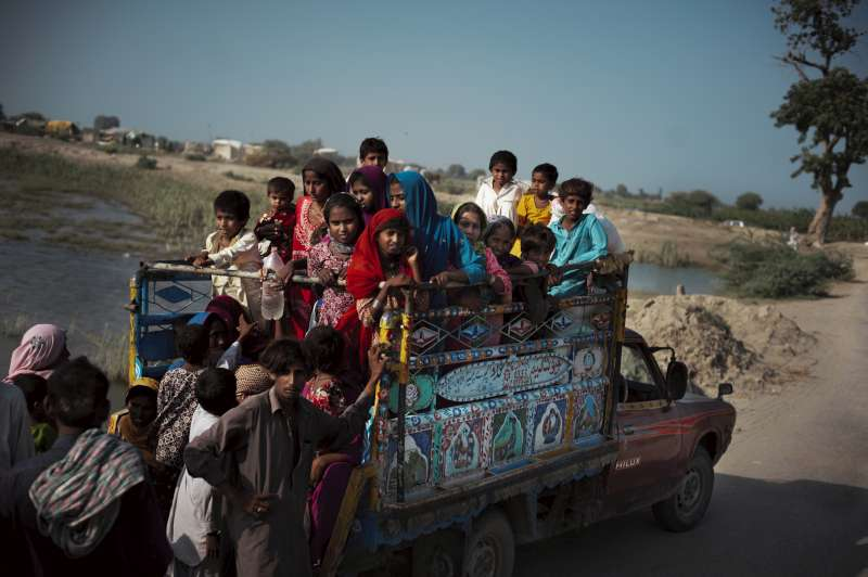Women and children crowd into a truck that will take them to […]
