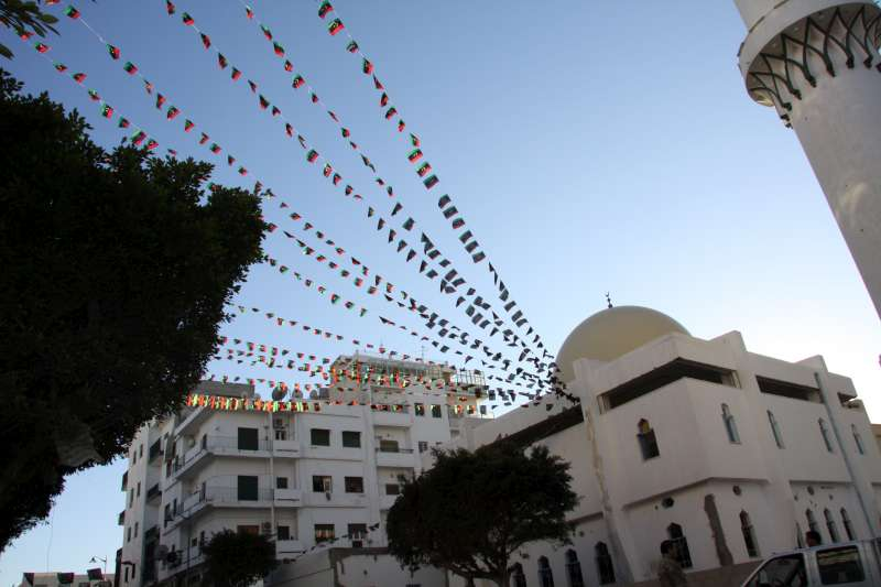 Strings of Libya's new flag flutter from a mosque in Tripoli […]
