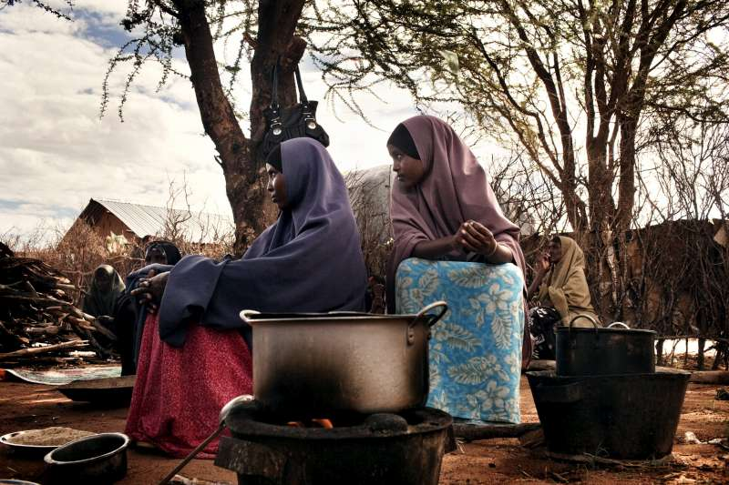 Refugees cook a meal in Dadaab camp.