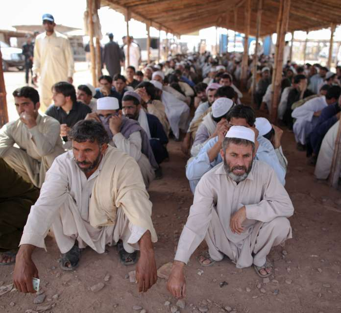 Men wait to register their families at Jalozai camp in north-west […]