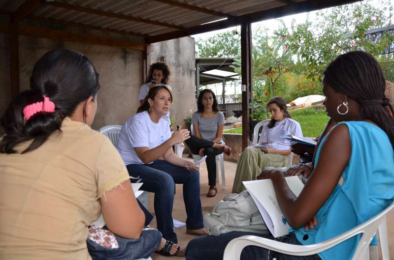 In Brasília, a UNHCR staff  member talks to refugees about their […]