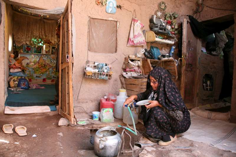 Afghan refugee Zahra Niazi fills a kettle in her house in Rafsanjan […]