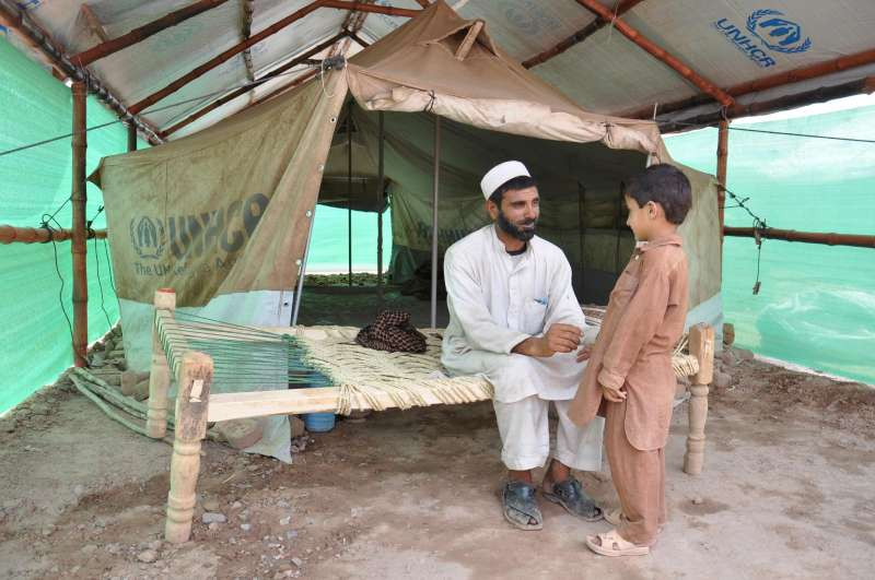 Lal Khan spends time with his son in the familyu0027s newly-constructed tent shelter. The shelters which are being built in the Jalozai c& for the internally ... & UNHCR - For those forced to live under canvas a simple solution ...