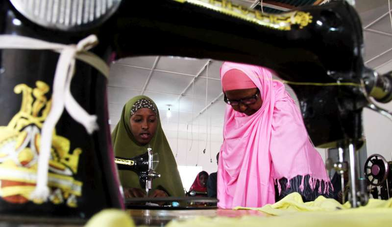 A tailoring class at the GECPD centre in Galkayo, Somalia. Displaced women are particularly vulnerable and have often been victims of domestic violence and rape. The skills training gives them hope for a better future.
