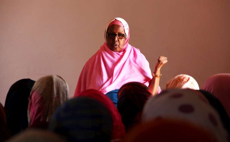 "Mama Hawa speaks to a group of internally displaced women at the Halabokhad settlement in Galkayo, Somalia. She believes that ""illiteracy in women is the reason why they can't demand their rights."""