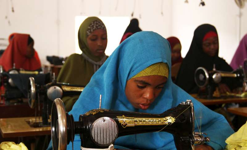 "Young IDP girls learn new tailoring skills in Galkayo, Somalia. This training provides an income for the girls. ""Seeing these girls earning a living, it is a good feeling,"""
