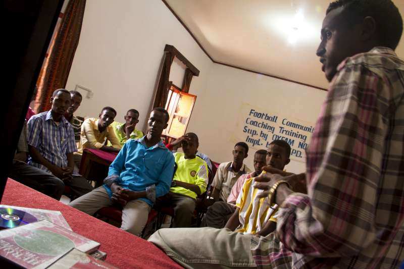 Internally displaced Somali boys listen to a lecture about soccer strategy at the Education Centre for Peace and Development in Galkayo.