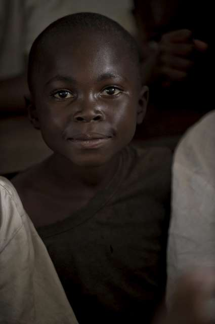 "A portrait of 10-year-old Sukuru, whose name means ""thank you"" in Swahili. He was photographed in Mugunga III months after fleeing his home village and becoming separated from his family for several days. ""I had old shoes and I could not follow,"" he said. The boy now hopes that the school will reopen soon in the camp so he can resume his education in this volatile corner of the world."