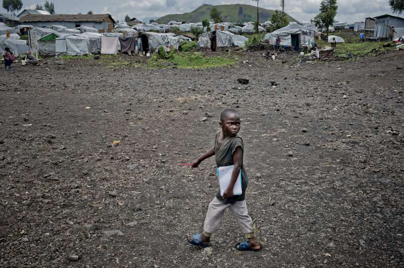 Sukuru on his way to school in Mugunga III. Classes have been cancelled until the security situation returns to normal. The school is open to local children as well as the displaced youngsters. Sukuru says he wants to become a teacher with a house and a car.