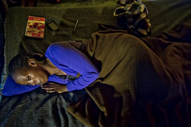 "Furaha is bedridden in her home, a tent in the camp of Kigeme. Today, she does not feel well and it is raining outside. ""My head is aching and I have fever,"" she says. The medicine prescribed for her is too expensive. She lives with her two children and has suffered a lot."