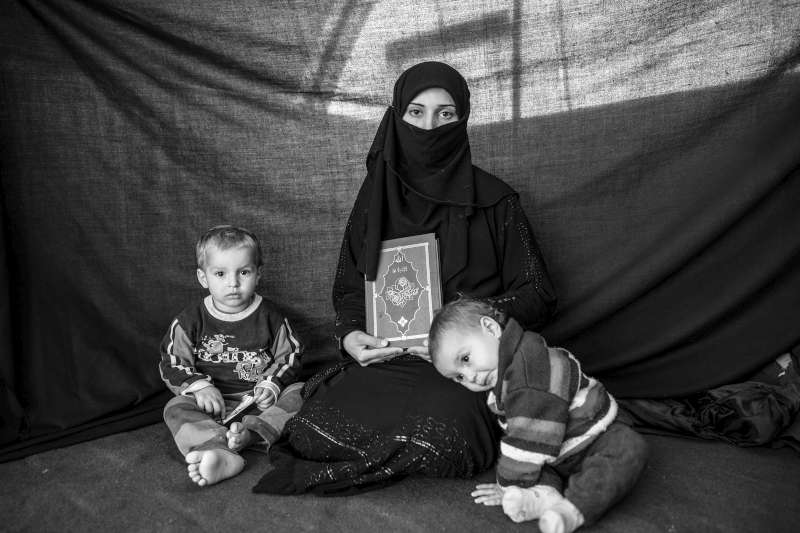 Iman, 25, with her son Ahmed and daughter Aishia, in Nizip refugee […]