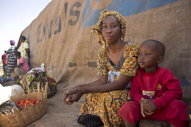 Aicha, 28, waits with her four-year-old son to take the boat […]