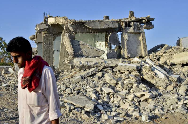 Mahdhar, aged 30, walks past a destroyed youth and sports centre […]