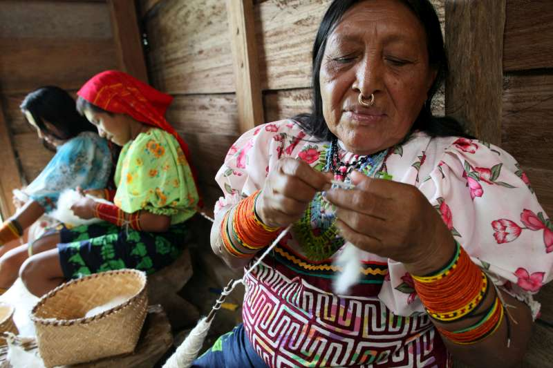 These indigenous Tule women in Colombia's Choco region prepare cotton to be used in making traditional clothes and material. They have only recently been able to return to their land, but damage to the environment and the presence of armed groups makes their future uncertain. The land and their connection to it is very important in Tule culture.