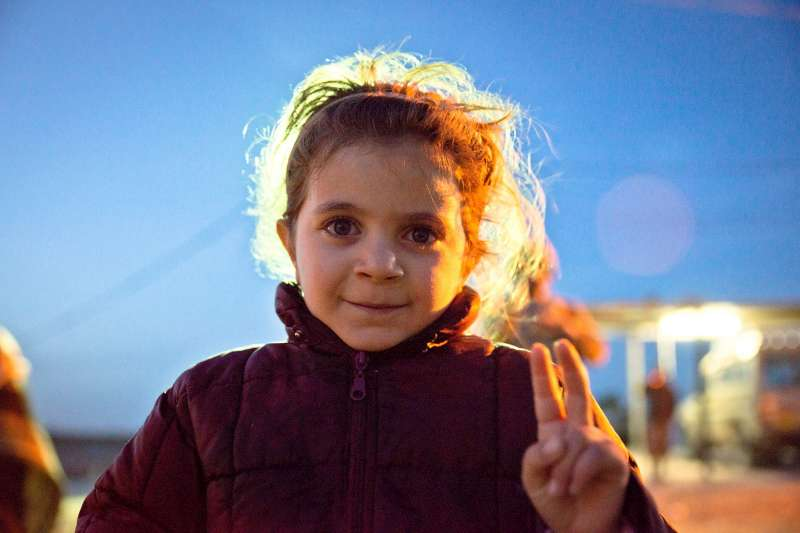 A young Syrian refugee flashes the victory sign near the Jaber border crossing.