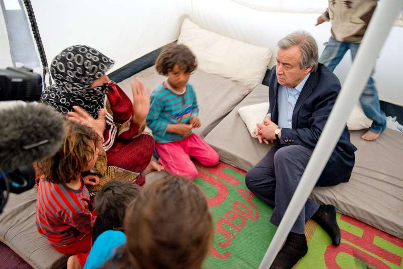 UN High Commissioner for Refugees António Guterres meets with a widow and her children from Aleppo, Syria, during a visit to Za'atri refugee camp in the north of Jordan.