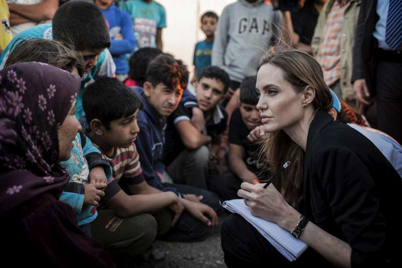 UNHCR Special Envoy Angelina Jolie records the stories of refugees who have just escaped the war in Syria at the Jaber border crossing in Jordan on 18 June.