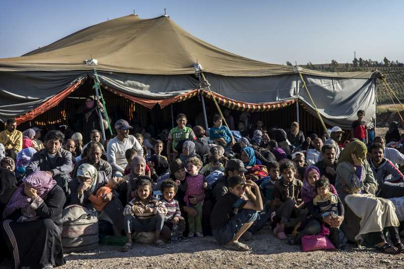 Newly arrived Syrian refugees await transfer to the Za'atri refugee camp from the Jordanian military camp near the border.