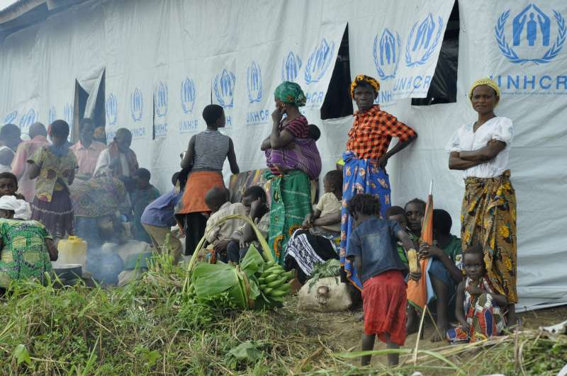 Congolese refugees outside one of the communal halls where new arrivals are being allocated space.