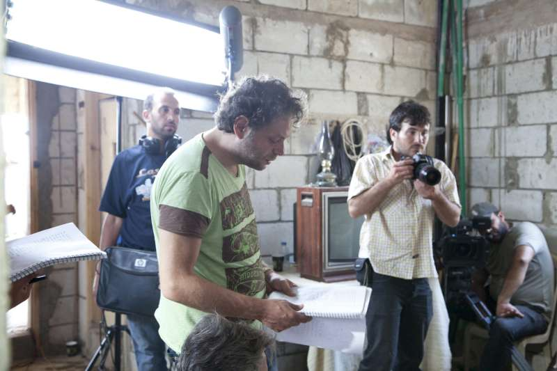 Syrian director Saifeddine Al Sibaii reads on set from the script […]