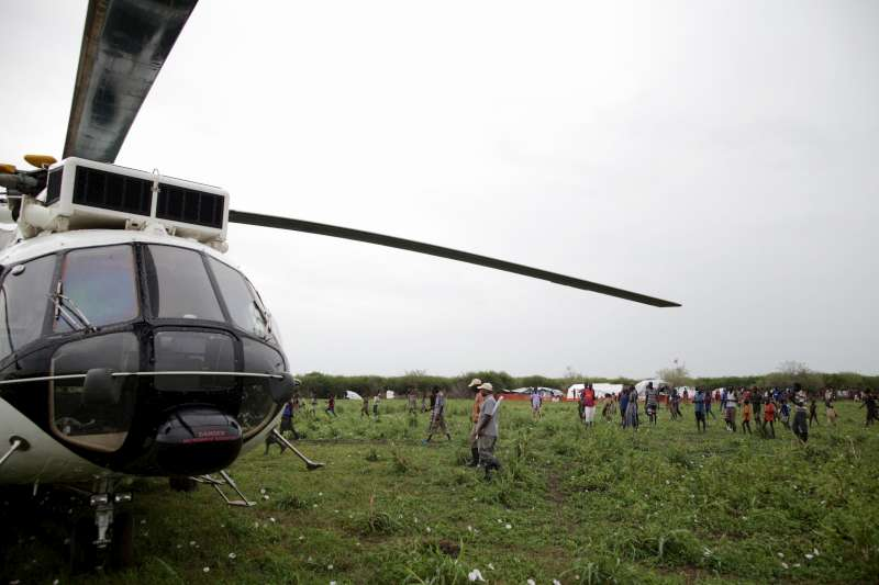 A helicopter operated by the World Food Programme unloads its […]