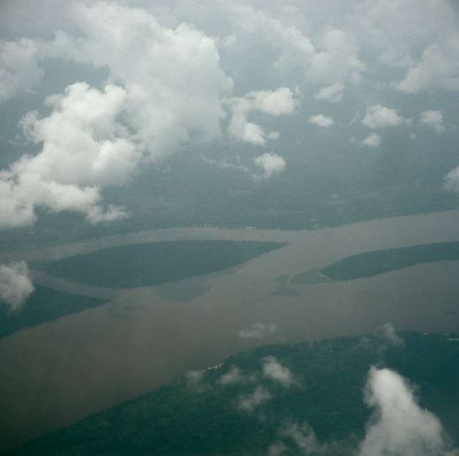 An aerial view of the Oubangui River as it threads its way between […]