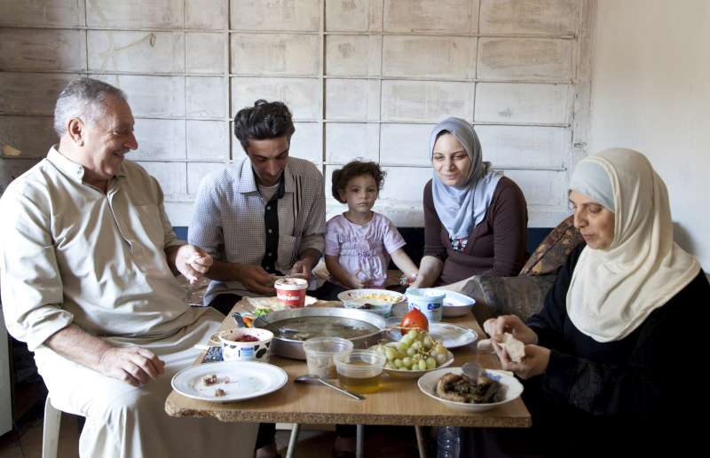 Ahmad (second from left) shares a final meal with his parents, […]