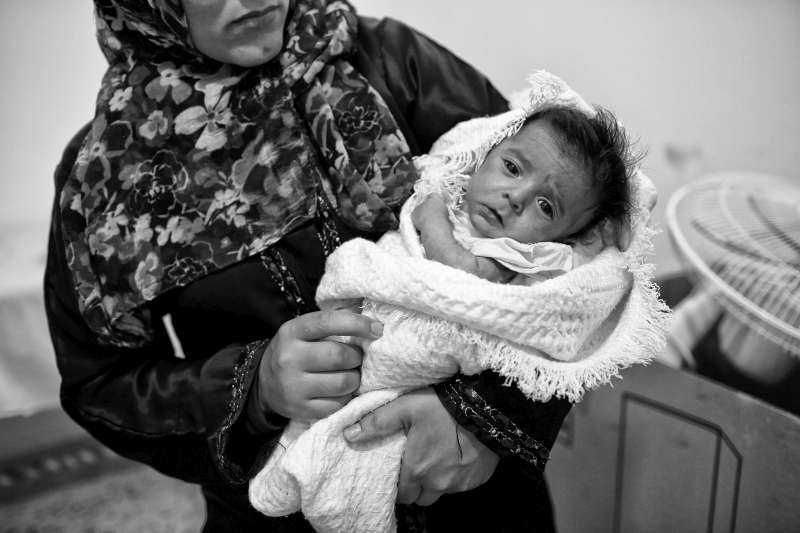 Syrian refugee Faseela holds her two-month-old son, Ali, at the […]