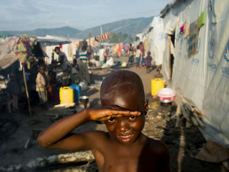 A Congolese boy shields his eyes from the sun amid the bustle […]