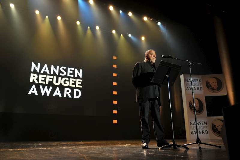 Brazilian best-selling author Paulo Coelho, the evening's keynote speaker, addresses the Nansen Refugee Award ceremony.