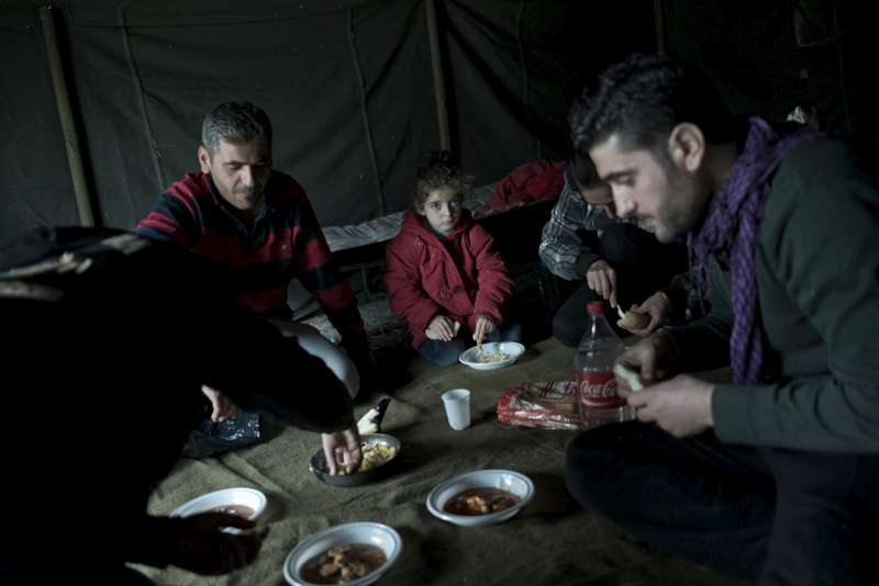 Displacement and flight have brought people together. In this tent in Harmanli camp, Christian and Muslim families share food and fellowship.