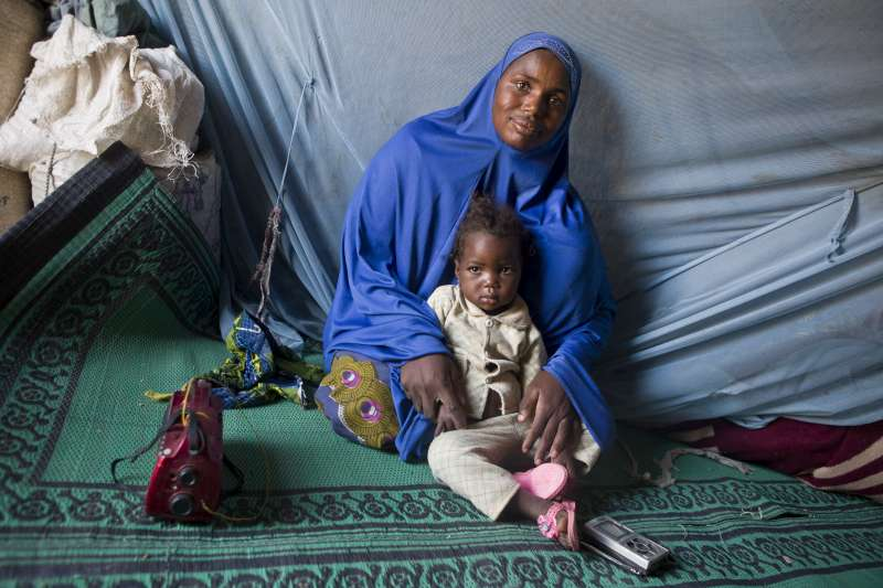 Fatouma, seen with one of her five children, left her village […]