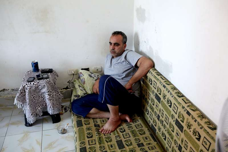 Mohamed, Mahmoud's father, in their home in a satellite city of Cairo. He used to travel the region selling leather goods, but in Egypt he sold bread to his neighbours to try and make ends meet.